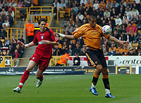 Photo: Kevin Poolman.<br />Wolverhampton Wanderers v Colchester United. Coca Cola Championship. 14/10/2006. Wolves striker Jay Bothroyd gets away fom Colchester defender Greg Halford.