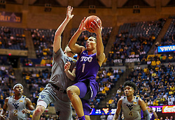 Jan 14, 2020; Morgantown, West Virginia, USA; TCU Horned Frogs guard Desmond Bane (1) drives down the lane guarded by West Virginia Mountaineers guard Chase Harler (14) during the first half at WVU Coliseum. Mandatory Credit: Ben Queen-USA TODAY Sports