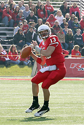 05 November 2011:  Matt Brown sets to throw a hail Mary pass as time expires the first half of play during an NCAA football game between the Western Illinois Leathernecks and the Illinois State Redbirds at Hancock Stadium in Normal IL