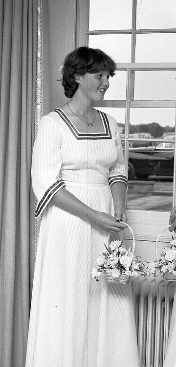 SARAH FERGUSON as a bridesmaid at her sister Jane's wedding at their home in Dummer, Hampshire in July 1976.