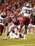 Nov 5, 2011; Fayetteville, AR, USA;  Arkansas Razorback defensive end Jake Bequette (91) blocks South Carolina Gamecocks cornerback Marty Markett (39) and linebacker Damario Jeffery (33) during an extra point attempt at a game at Donald W. Reynolds Stadium.  Mandatory Credit: Beth Hall-US PRESSWIRE