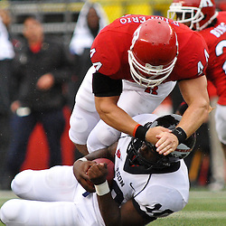 Sep 12, 2009; Piscataway, NJ, USA; Rutgers linebacker Ryan D'Imperio (44) tackles Howard quarterback Floyd Haigler (10) on a quarterback scramble during the first half of Rutgers' 45-7 victory over Howard in NCAA College Football at Rutgers Stadium.