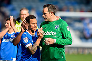 Portsmouth Goalkeeper, David Forde (1) and Portsmouth Midfielder, Kyle Bennett (23) celebrate at full time during the EFL Sky Bet League 2 match between Portsmouth and Cambridge United at Fratton Park, Portsmouth, England on 22 April 2017. Photo by Adam Rivers.