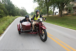 Gary Wright riding his 1930 Indian Chief with his wife Linda Bendorf in the sidecar duringStage 6 of the Motorcycle Cannonball Cross-Country Endurance Run, which on this day ran from Cape Girardeau to Sedalia, MO., USA. Wednesday, September 10, 2014.  Photography ©2014 Michael Lichter.