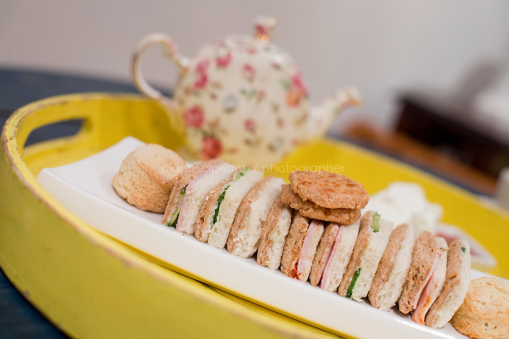 """5 November, 2008. New York, NY. An assortment of tea sandwiches is on a tray here at the Podunk, a self-styled """"American tearoom"""" in the East Village.The owner, Elspeth Treadwell, left a career in publishing to open Podunk six years ago, in 2002. <br /> <br /> ©2008 Gianni Cipriano for The New York Times<br /> cell. +1 646 465 2168 (USA)<br /> cell. +1 328 567 7923 (Italy)<br /> gianni@giannicipriano.com<br /> www.giannicipriano.com"""