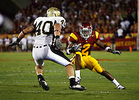 1 September 2007: Idaho #40 Dvid Vobora tries to stand in the way of Tailback #2 C.J. Gable in action during the USC Trojans college football team defeated the Idaho Vandals 38-10 at the Los Angeles Memorial Coliseum in CA.  NCAA Pac-10 #1 ranked team first game of the season.