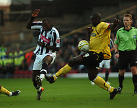 Photo: Tony Oudot/Sportsbeat Images.<br /> Watford v West Bromwich Albion. Coca Cola Championship. 03/11/2007.<br /> Ishmael Miller of West Brom clashes with Dan Shittu of Watford