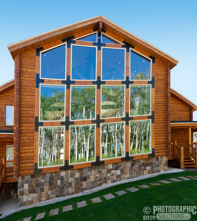 This is the exterior of an enormous cabin,the windows here are more than three stories tall.