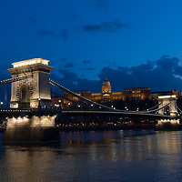 White light painting illuminates Budapest landmark Chain Bridge in support for the healthcare workers during the COVID19 pandemic in Budapest, Hungary on March 28, 2020. ATTILA VOLGYI