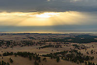 Early morning crepuscular rays illuminate the Black Hills and the Great Plains beyond. This was the view from the Rankin Ridge lookout tower.