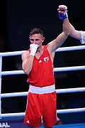 Marcel Rumpler of Austria (red) celebrates beating Delano James of The Netherlands (bue) in the Men's Welterweight preliminaries during The Road to Tokyo European Olympic Boxing Qualification, Sunday, March 15, 2020, in London, United Kingdom. (Mitchell Gunn-ESPA-Images/Image of Sport)