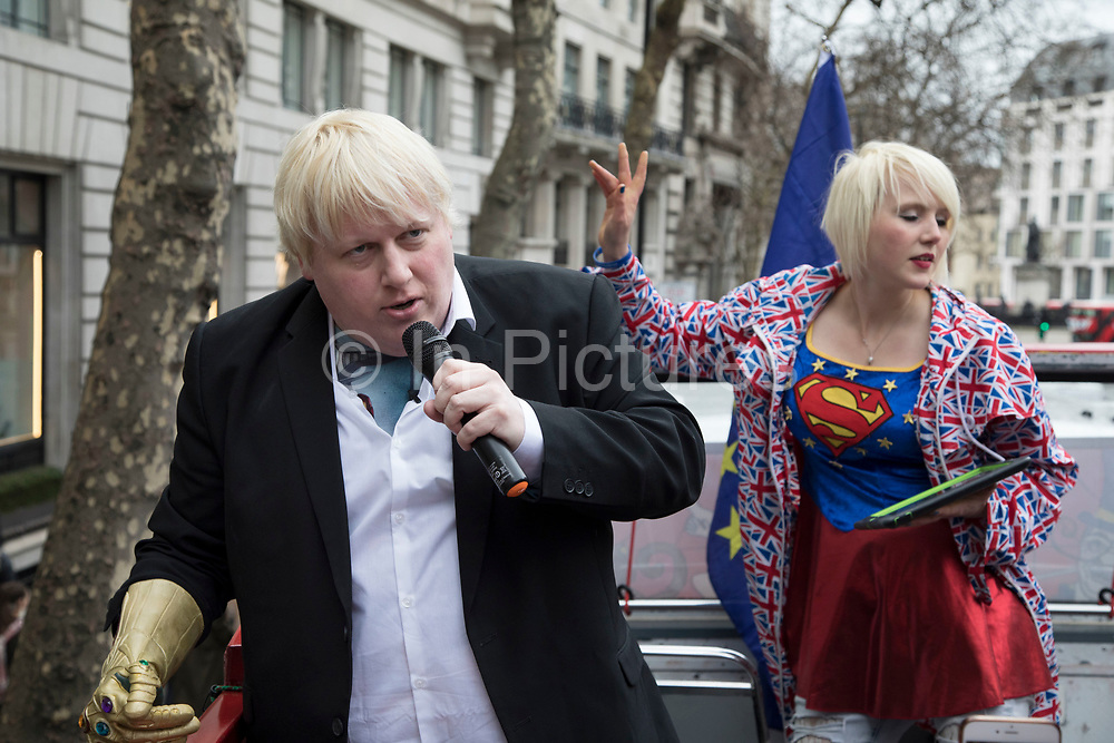 With one year to go until Brexit, anti-Brexit, pro-Europe demonstrators protest including a Boris Johnson lookalike in favour of staying in the European Union aboard an EU superhero Brexit battle bus on 29th March 2018 in London, England, United Kingdom. As the Tories continue their negotiations with EU leaders, protesters make their views heard throughout the capital.