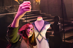 © Licensed to London News Pictures. 09/02/2015. London, UK. A woman takes a photo of exhibits at the Game of Thrones Exhibition on 9th February 2014 at the O2 Arena in Greenwich, south-east London. Photo credit : Vickie Flores/LNP