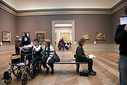 people sitting in a European Art gallery in the Metropolitan Museum of Art NYC