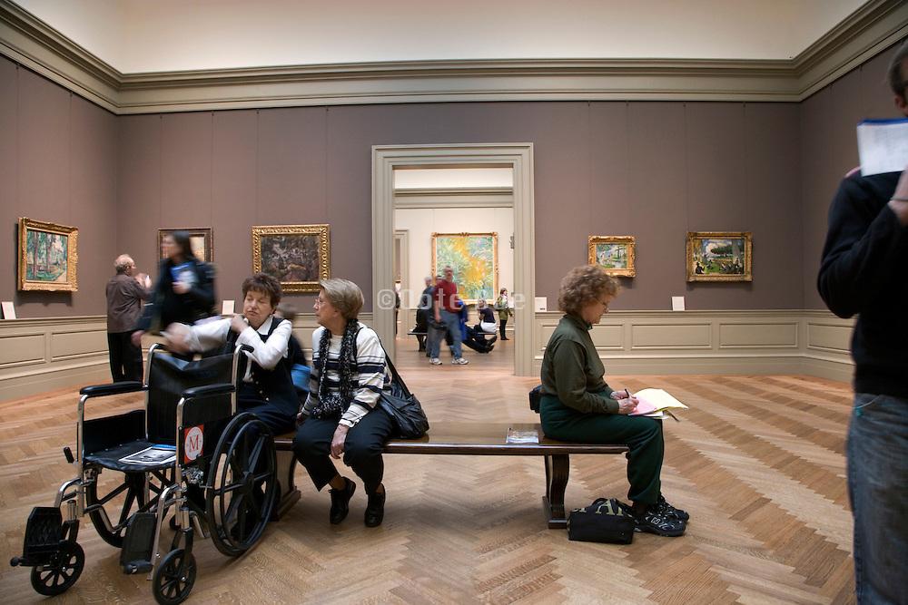 people sitting in a European Art gallery in the Metropolitan Museum of Art NYC