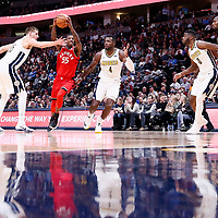 01 November 2017: Toronto Raptors guard Delon Wright (55) drives past Denver Nuggets center Nikola Jokic (15) and Denver Nuggets forward Paul Millsap (4) during the Denver Nuggets 129-111 victory over the Toronto Raptors, at the Pepsi Center, Denver, Colorado, USA.