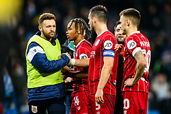 Matt Taylor greets Bobby Reid and Bailey Wright of Bristol City after Manchester City win 2-1 in added time - Rogan/JMP - 09/01/2018 - Etihad Stadium - Manchester, England - Manchester City v Bristol City - Carabao Cup Semi Final First Leg.
