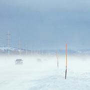 Cars drive along the Moose-Wilson Road near Wilson, Wyoming.