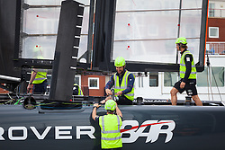 © Licensed to London News Pictures. 15/07/2016. Portsmouth, United Kingdom.  Wing Trimmer, Paul Campbell-James (sitting) and the Team Land Rover BAR (Ben Ainslie Racing) preparing their boat for training this morning at the BAR Headquarters on the Camber in Portsmouth. The team are currently preparing for the America's Cup World Series (ACWS) event being held in Portsmouth between 22-24th July 2016. Photo credit: Rob Arnold/LNP