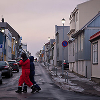 Walkers bundled against the cold in central Reykjavik, Iceland on Christmas day 2013.