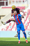 John Souttar (#4) of Heart of Midlothian FC wins a header against Shane Sutherland (#11) of Inverness Caledonian Thistle FC during the SPFL Championship match between Heart of Midlothian and Inverness CT at Tynecastle Park, Edinburgh Scotland on 24 April 2021.