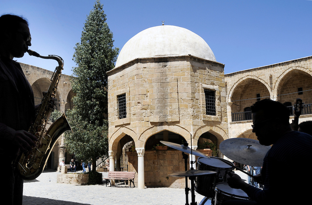 """Nicosia, (Lefkosa) North Cyprus ,19 April 2008 .The """"Jazz Brothers"""" band performs inside the Buyuk Han. Buyuk Han (Great Inn) is a former caravanserai that now houses cafés and shops. Below is the mescit (Islamic chapel) at the center of the courtyard..The Turkic Republic of Northern Cyprus (TRNC), commonly called Northern Cyprus, is a de facto independent republic located in the north of Cyprus. The TRNC declared its independence in 1983, nine years after a Greek Cypriot coup attempting to annex the island to Greece triggered an invasion by Turkey. It has received diplomatic recognition only from Turkey, on which it has become dependent for economic, political and military support. The rest of the international community, including the United Nations and European Union, recognises the sovereignty of the Republic of Cyprus over the territory of the TRNC...Photo Credit: EZEQUIEL SCAGNETTI"""