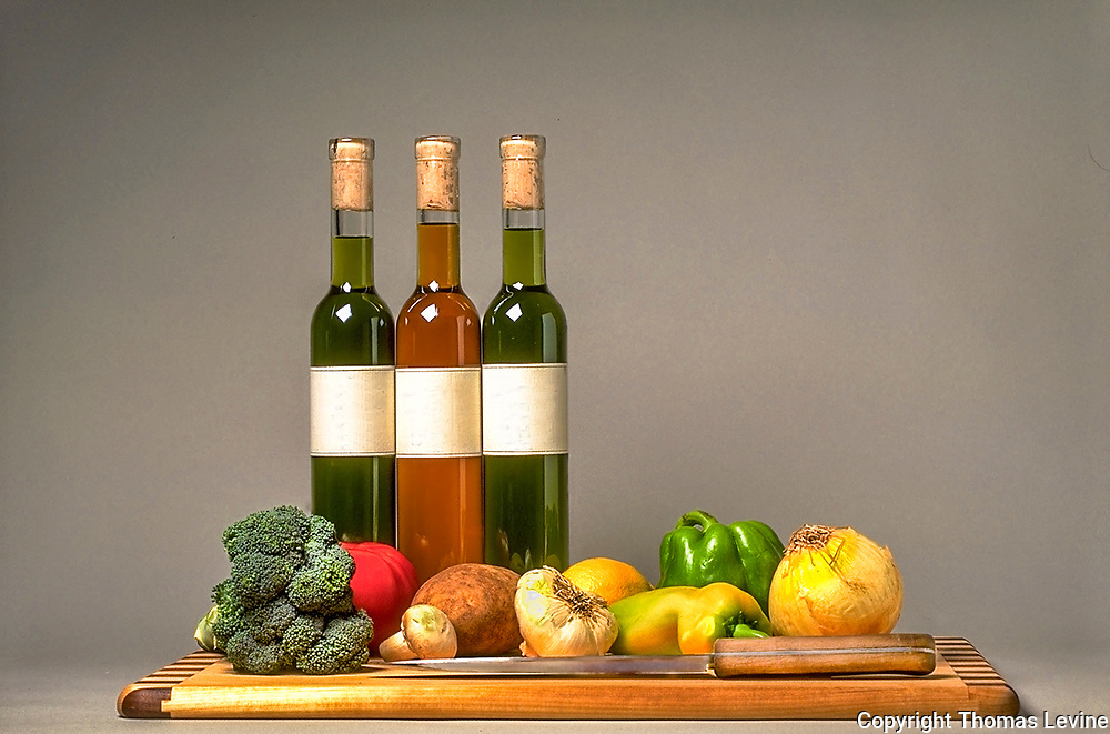 Infused cooking oils and vegetables for healthy eating food. Garlic, Chili. lemongrass oils.