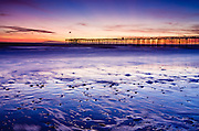 Sunset over the Channel Islands and Ventura Pier from San Buenaventura State Beach, Ventura, California USA