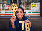 15 FEBRUARY 2020 - TAMPA, FLORIDA: A homeless person selling crosses woven out of palm fronds in the historic Ybor City district of Tampa, Florida.     PHOTO BY JACK KURTZ