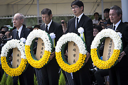 August 9, 2016 - Nagasaki, Nagasaki Prefecture, Japan - NAGASAKI, JAPAN - AUGUST 9 : Mayor of Nagasaki, representatives of bereaved families and representatives of Atomic bomb survivors lays wreath for the atomic bomb victims in front of the Peace Statue in Nagasaki Peace Park, Nagasaki, southern Japan, Tuesday, August 9, 2016. Japan marked the 71st anniversary of the atomic bombing on Nagasaki. On August 9, 1945, during World War II, the United States dropped the second Atomic bomb on Nagasaki city, killing an estimated 40,000 people which ended World War II. (Credit Image: © Richard Atrero De Guzman/NurPhoto via ZUMA Press)