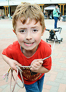 Robin Zielinski – Sun-NewsConnor Oliver, 5, of El Paso, pulls his roping dummy with determination on Saturday after learning about the skill for the first time during the 15th annual Cowboy Days at the New Mexico Farm & Ranch Heritage Museum. The event, which continues today, offers many activities for all ages including: crafts, gun-slinging shows, food vendors, musical entertainment and more.