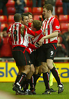 Photo. Andrew Unwin.<br /> Sunderland v Nottingham Forest, Nationwide League Division One, Stadium of Light, Sunderland 10/01/2004.<br /> Sunderland's Julio Arca (one from l) is mobbed by his teammates after scoring the first goal of the game.