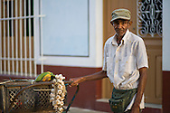 One of Cuba's new entrepreneurs selling garlic and fruits in the streets of Remedios