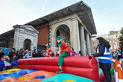 © Licensed to London News Pictures. 07/12/2019. LONDON, UK.  7 December 2019.  A participant take on an obstacle during The 39th Great Christmas Pudding Race in Covent Garden, raising funds for Cancer Research as well as having lots of festive fun.  Photo credit: Stephen Chung/LNP