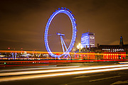 Photography by Roy Riley 0781 6547063<br /> roy@royriley.co.uk<br /> <br /> The London Eye at night with reflection and traffic streaks. Taken from Westminster Bridge Copyright Roy Riley 0781 6547063