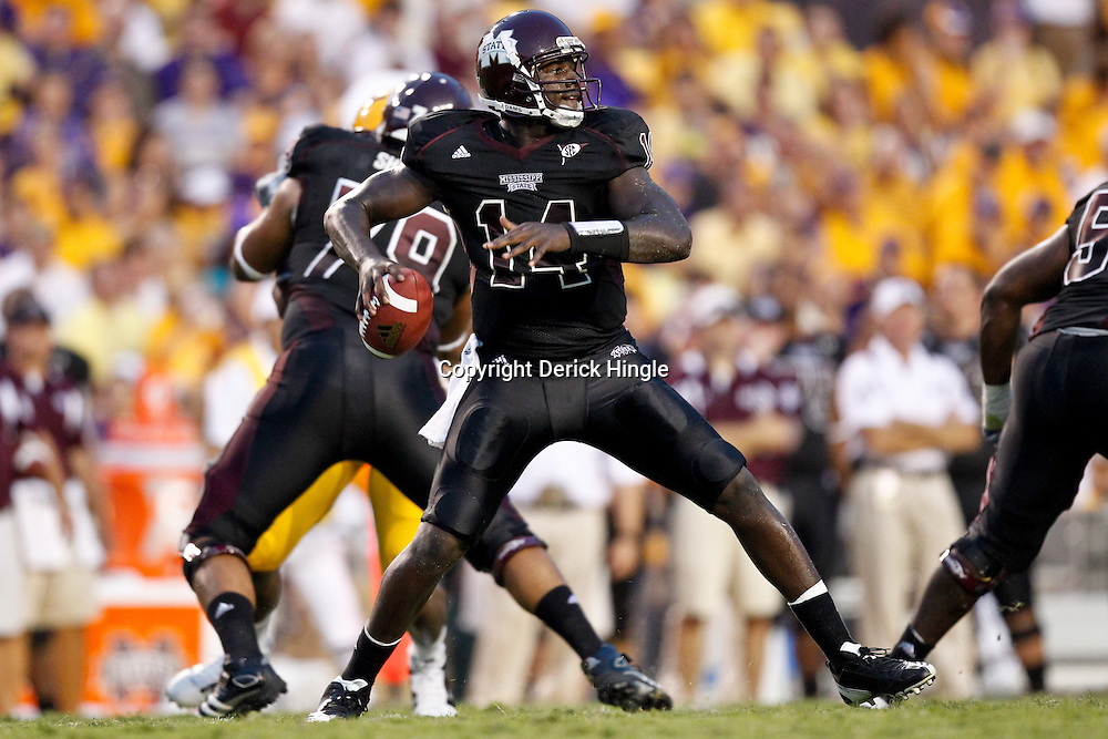 Sep 18, 2010; Baton Rouge, LA, USA; Mississippi State Bulldogs quarterback Chris Relf (14) passes the ball during the first half against the LSU Tigers at Tiger Stadium.  Mandatory Credit: Derick E. Hingle