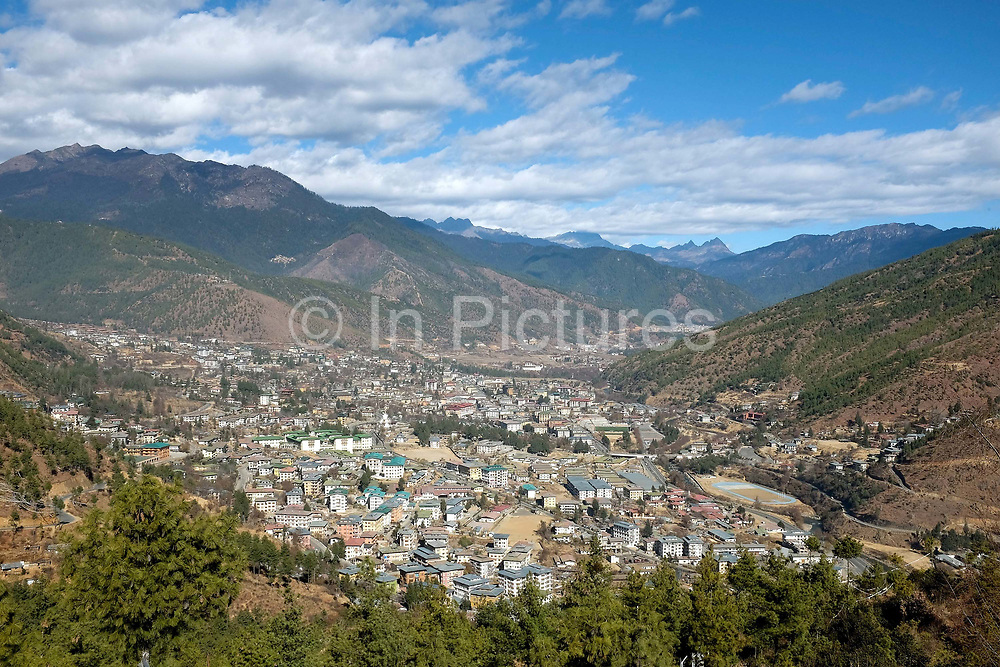 Situated in Western Bhutan, Thimphu is the capital city and also the name of the valley which has an average elevation of 2300m. With an estimated population of around 100,000 Thimphu is Bhutan's largest city. Rapid expansion following rural exodus has resulted in rebuilding in the city centre and mushrooming suburban development elsewhere. By regulation, all buildings are required to be designed in traditional style with Buddhist paintings and motifs.