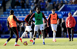 Manchester United's Paul Pogba (centre) warms up on the pitch prior to the Premier League match at the King Power Stadium, Leicester.