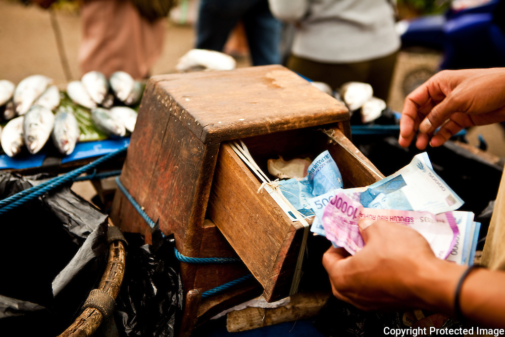 money box at vendors stall in Rantepao, Sulawesi market, Indonesia
