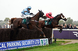 Fat Sam ridden by jockey James Davies (left) clear a fence on their way to winning the Colliers Saves Business Rates Handicap Chase at Warwick Racecourse. Picture date: Thursday September 30, 2021.