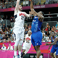 29 July 2012: USA Kevin Love goes for the skyhook over Kevin Seraphin of France during the 98-71 Team USA victory over Team France, during the men's basketball preliminary, at the Basketball Arena, in London, Great Britain.