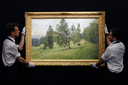 "© Licensed to London News Pictures. 02/06/2017. London, UK. Technicians present ""Summer"", 1891, by Isaak Levitan (est. 1-1.5m).  Preview of Sotheby's sale of Russian pictures and works of art which takes place on 6 June 2017 at Sotheby's in New Bond Street. Photo credit : Stephen Chung/LNP"