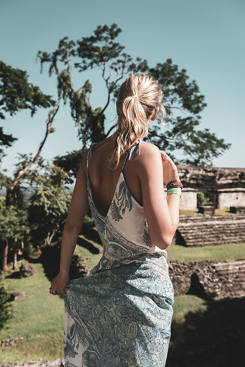 Palenque, Mexico - November 24, 2014: Chloe, from Australia, takes in the view from atop the Temple of the Count in Palenque, Mexico. The Mayan city flourished in the 7th century.