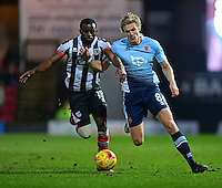 Blackpool's Brad Potts vies for possession with Grimsby Town's Tom Bolarinwa<br /> <br /> Photographer Chris Vaughan/CameraSport<br /> <br /> The EFL Sky Bet League Two - Grimsby Town v Blackpool - Saturday 31st December 2016 - Blundell Park - Grimsby<br /> <br /> World Copyright © 2016 CameraSport. All rights reserved. 43 Linden Ave. Countesthorpe. Leicester. England. LE8 5PG - Tel: +44 (0) 116 277 4147 - admin@camerasport.com - www.camerasport.com