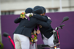 L-R Britta Napel (GER, Silver), Natasha Baker (GBR, Gold) and Angelika Trabert (GER, Bronze)<br /> Individual Championship Test  - Grade II <br /> London 2012 Paralympic Games<br /> © Hippo Foto - Jon Stroud