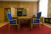Desk in the preserved office of former Minister in charge of GDR secret police chief, Erich Mielke - an exhibit in 'Haus 1' the ministerial headquarters of the Stasi secret police in Communist East Germany, the GDR. Built in 1960, the complex now known as the Stasi Museum. Before the fall of the Wall, it was a 22-hectare complex of espionage whose centrepiece is the office and working quarters of the former Minister of State Security, Mielke who considered their role as the 'shield and sword of the party', conducting one of the world's most efficient spying operations against its political dissenters during its 40-year old socialist history. After the fall of the socialist state, Mielke was sentenced to 6 years in prison and died in 2000, aged 92. During Hitler's Third Reich, the Gestapo had one agent for every 2,000 citizens whereas the Stasi had approximately an spy for every 6.5. Here at the Stasi HQ alone 15,000 were employed plus the many regional stations. German media called East Germany 'the most perfected surveillance state of all time' - administered from this complex of offices.