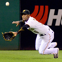 Pittsburgh Pirates left fielder Starling Marte (6) dives but misses the catch allowing St. Louis Cardinals second baseman Kolten Wong (16) a double in the eighth inning of the 11-1 St. Louis Cardinals win that clinches the National League Central Division in game two of the doubleheader at PNC Park in Pittsburgh on September 30, 2015.  Photo by Archie Carpenter/UPI
