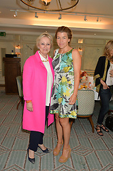 Left to right, PAMELA HARPER Chairman & CEO of Halcyon Days and AMBER NUTTALL at a breakfast hosted by Halcyon Days at Fortnum & Mason, 181 Piccadilly, London on 8th July 2014.