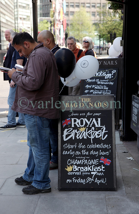 21 April 2011. London, England..A pub sign near Buckingham Palace offering 'Royal Breakfast' in the run up to Catherine Middleton's marriage to Prince William..Photo; Charlie Varley.