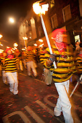 Lewes, UK. Monday 5th November 2012. Members of Commercial Square bonfire society carry burning torches on Bonfire Night celebration in the town of Lewes, East Sussex, UK which form the largest and most famous Guy Fawkes Night festivities. Held on 5 November, the event not only marks the date of the uncovering of the Gunpowder Treason and Plot in 1605, but also commemorates the memory of the 17 Protestant martyrs from the town burnt at the stake for their faith during the Marian Persecutions of 1555–57. There are six bonfire societies putting on parades involving some 3,000 people.